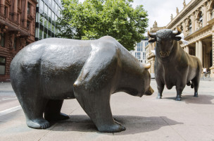 A bear and a bull statue stand outside the Frankfurt Stock Exchange in Frankfurt, Germany, on Wednesday, July 30, 2014. The U.S. is considering further punitive measures on Russian business after Europe expanded its blacklist of tycoons close to the Kremlin to pressure President Vladimir Putin to halt backing for separatists in east Ukraine. Photographer: Martin Leissl/Bloomberg via Getty Images