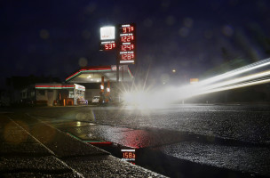 "A fuel price at a Star gas station is reflected in a puddle in the village of Klein-Auheim, Hanau, Germany, February 1, 2016. Unleaded petrol is priced at 1.229 euros ($1.34) a litre. A dramatic drop in oil prices, driven down by a glut in supply, is translating into a mixed bag for motorists. All countries have access to the same oil prices on international markets, but retail prices vary wildly, largely because of taxes and subsidies. Picture taken with a long exposure. REUTERS/Kai Pfaffenbach    SEARCH ""THE WIDER IMAGE"" FOR ALL STORIES"