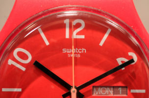 The Swatch logo and numerals sit on a wristwatch face inside a watch store, operated by Swatch Group AG, in London, U.K., on Friday, Jan. 16, 2015. The Swiss National Bank spoiled the party for the country's luxury watchmakers just as they were preparing for some of the most lavish bashes of the year next week at the annual Geneva watch show. Photographer: Chris Ratcliffe/Bloomberg via Getty Images