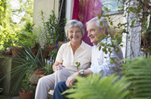 Senior couple sitting on back door steps
