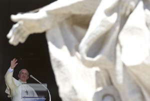 Pope Francis waves as he leads the Sunday Angelus prayer from the window of the Apostolic Palace in Saint Peter's Square at the Vatican