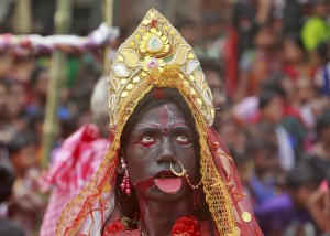 Devotee dressed as Hindu goddess Kali performs during a ritual as part of the annual Shiva Gajan religious festival at Pratapgarh