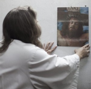 epa03994811 (01/15) US James Joseph, a Catholic pilgrim originally from Detroit, Michigan, touches the picture of Jesus at the Church of the Holy Sepulcher at the Old City of Jerusalem, 07 May 2013. Joseph calls himself Jacob but is better known by many as 'the Jesus guy', mainly because of his appearance resembling Jesus Christ. He has visited about 20 countries in the world, spreading his message, and over recent years he has been visiting Israel, becoming a well-known figure in the old city of Jerusalem, where he explores the life and path of Jesus Christ.  EPA/ABIR SULTAN PLEASE REFER TO ADVISORY NOTICE  (epa03994810) FOR FULL FEATURE TEXT