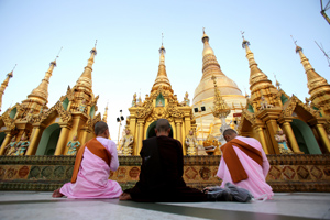 Buddhist nuns pray at a religious event leading to the festival of lights at Shwedagon pagoda in Yangon, Myanmar on Sunday, Nov. 22, 2015. The festival marks the end of the rainy season and is an occasion for Burmese people to pay their respects in the predominantly Buddhist country. (AP Photo/Hau Dinh)