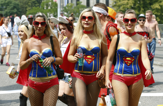 Revellers dress as comic character Superwoman during the 23nd Street Parade dance music event in Zurich