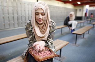 "This photograph may only be used together with the 21 August 2014 package WEARING A VEIL IN BRITAIN.  Ameera, 12, waits to go ice skating in east London March 8, 2014. Ameera first wore the hijab as part of her primary school uniform. She started to wear it full time age 9 because most of her friends wore the hijab. Her mother would tell her ""You don't have to wear it. You're still young!"" She loves to wear the hijab and has as many as 60 or 70 different scarves. Reuters photographer Olivia Harris took portraits of a range of Muslim women in Britain and asked them why they chose to wear a hijab or veil. Picture taken March 8, 2014. REUTERS/Olivia Harris (BRITAIN - Tags: SOCIETY RELIGION)  ATTENTION EDITORS PICTURE 11 OF 15 FOR PACKAGE 'WEARING A VEIL IN BRITAIN' SEARCH 'HARRIS HIJAB' FOR ALL IMAGE - RTR437EW"
