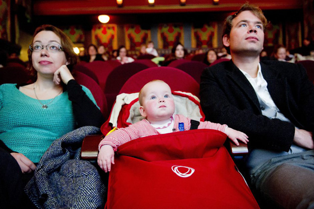 epa03137953 Parents accompanied with their babies attend a movie at the cinema 'The Movies' in Amsterdam, The Netherlands, 09 March 2012. From now on, the cinema offers an special program for parents who want to watch the movies with their babies.  EPA/ROBIN UTRECHT