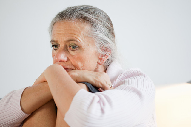 Mature woman looking anxious