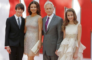 "Husband and wife actors Catherine Zeta-Jones and Michael Douglas arrive with children Dylan and Carys for the European premiere of ""Ant-Man"" at Leicester Square in London, Britain July 8, 2015. REUTERS/Luke MacGregor - RTX1JME6"