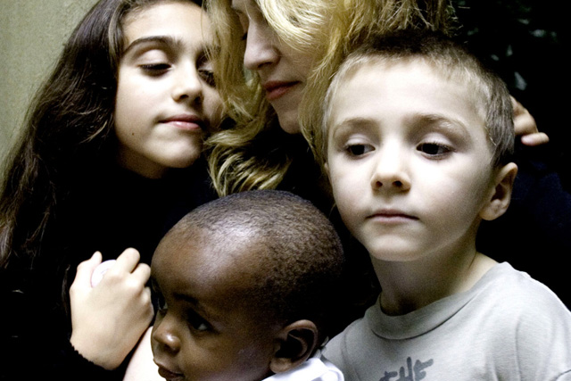 """In this undated handout photo provided by Madonna's publicist Liz Rosenberg, Madonna is shown with her daughter Lourdes, 9, left, son Rocco, 6, right and David Banda, 13-months, who she plans to adopt with her husband director Guy Ritchie. Madonna said that David is healthy and thriving in her London home, in an interview that aired Wednesday, Oct. 25, 2006, on """"The Oprah Winfrey Show."""" The child was taken to London last week after Malawi's High Court granted Madonna and her husband, director Guy Ritchie, an interim adoption order. (AP Photo/Shavawn Rissman) ** **"""