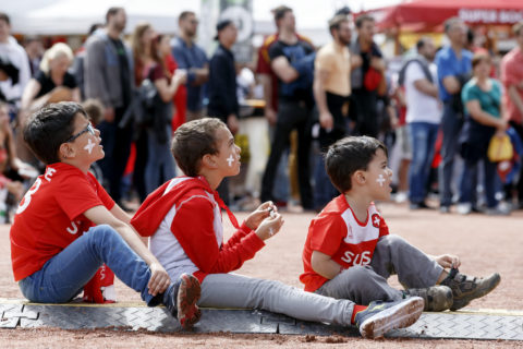 Fans of Switzerland's national soccer team celebrate the Swiss victory as they watch the live broadcast of the Euro 2016 European Soccer Championships match between Albania and Switzerland, in Geneva, Switzerland, Saturday, June 11, 2016. (KEYSTONE/Salvatore Di Nolfi)