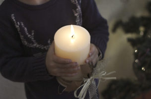 Little boy holding a candle