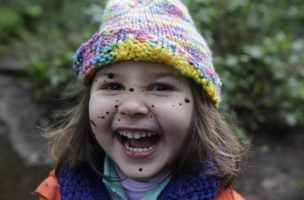 Beulah Ellison-Taylor, 3, shows her delight in splashing mud on her face as she attends Cedarsong Nature School's outdoor preschool, Wednesday, May 5, 2010, on Vashon Island, near Seattle. Students at the three-hour-a-day school spend the entire time outside in nature. (AP Photo/Ted S. Warren)