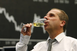 A bourse trader drinks champagne after the last trading day at Frankfurt's stock exchange in Frankfurt