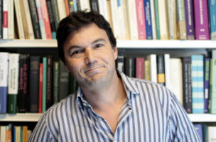 French economist Thomas Piketty poses in his office in Paris