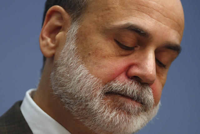 U.S. Chairman of the Federal Reserve Bernanke looks down while speaking at the Brookings Institution in Washington