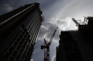 A crane is silhouetted at a construction site in central London