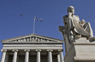 A Greek flag flutters at the Athens Academy
