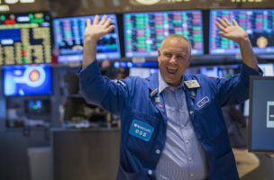 Specialist Friedman reacts to the Dow Jones industrials average passing 17,000 on the floor of the New York Stock Exchange