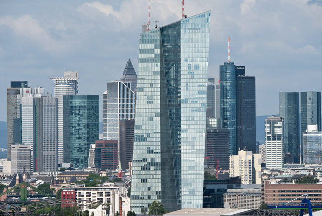 epa04838329 The skyline of the city center of Frankfurt/Main, Germany, including the new headquarters of the European Central Bank (ECB), in front, seen on 09 July 2015. Visible from (L-R) are the Tower 185 (back), the Silver Tower, the Eurotower, the Westend 1 Tower (back), the Skyper, the Taunusturm tower, the Messeturm Fair tower (back), the new ECB (front), the Main Tower and the Twin Towers of the Deutsche Bank. The high-rise buildings in the city's center caused the public to nickname the business district 'Mainhattan'. EPA/BORIS ROESSLER