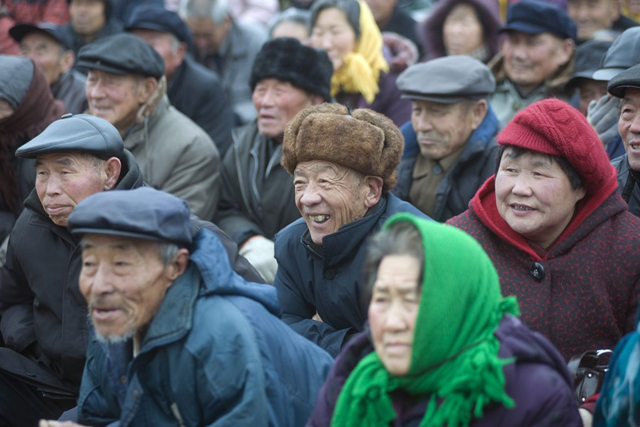 epa03149809 Chinese rural eldery people gather to watch a local opera in a rural area of Jimo, eastern China's Shandong province, 18 March 2012. Reports state that the Chinese population of people aged 60 or above reached at 185 million by the end of 2011, or 13.7 per cent of the nation's total population while China's aging population and the deteriorating natural environment will constrain economic growth, according to Ma Jiantang, head of the National Bureau of Statistics said on 17 March 2012. EPA/WU HONG
