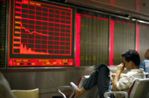 A Chinese investor monitors stock prices at at a brokerage house in Beijing, Monday, Aug. 24, 2015. Stocks tumbled across Asia on Monday as investors shaken by the sell-off last week on Wall Street unloaded shares in practically every sector. (AP Photo/Mark Schiefelbein)