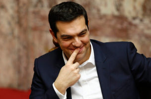 epa04604304 Alexis Tsipras, Prime Minister of Greece and President of the radical left party of SYRIZA , smiles during the swearing-in ceremony of the new deputies that were elected in the January 25 national polls, in Athens, Greece, 05 February 2015. On 06 February, the deputies will elect the President and the Vice-Presidents of the Parliament, while in the next three days the new government will make its policy announcements. This procedure will be concluded on 09 February night, when deputies will be asked to give a vote of confidence to the new government.EPA/POOL/YANNIS BEHRAKIS  EPA/YANNIS BEHRAKIS