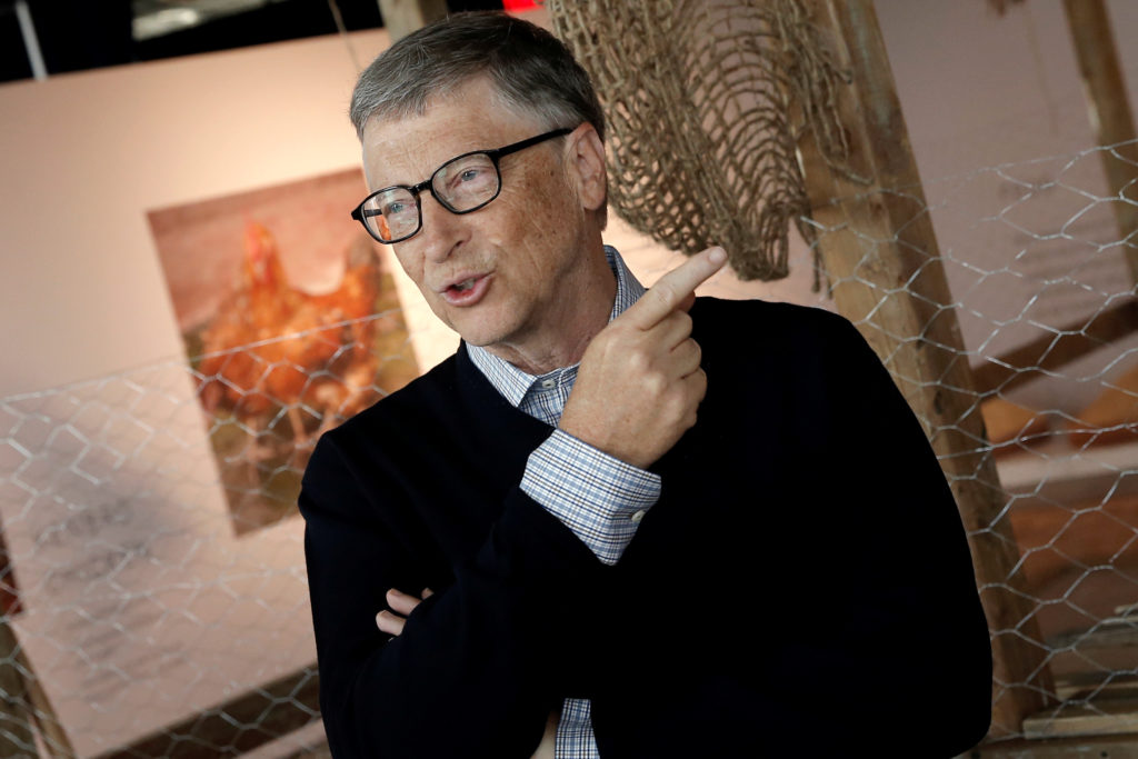 Billionaire philanthropist and Microsoft's co-founder Bill Gates speaks to the media, in front of a chicken coop set up on the 68th floor of the 4 World Trade Center tower, in Manhattan, New York, U.S., June 8, 2016, while announcing that he is donating 100,000 chicks to developing countries with the goal of ending extreme poverty. REUTERS/Mike Segar - RTSGN0V