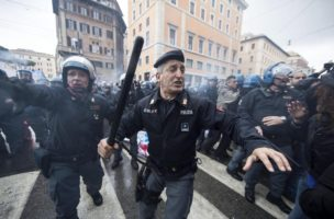 epa04513276 Italian Police clash demonstrators in Rome, Italy on 03 December 2014 during a  a demonstration in Rome against the government's Jobs Act labour reform bill. Three protesters were injured in a police charge at the demonstration. The protest organized by the self-styled National Social Strike Laboratory said high school students occupying their schools this week also participated in the march through central Rome, which turned into a melee when protesters tried to break through a police cordon around the Senate building, setting off flares and throwing eggs at law enforcement. The government's Jobs Act labour reform bill now on the floor of the Senate, where the administration of Premier Matteo Renzi looks set to call a confidence vote.  EPA/MASSIMO PERCOSSI