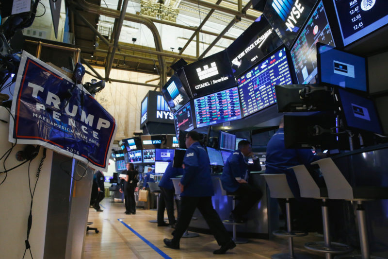 An electoral poster of Donald Trump is displayed on the floor of the New York Stock Exchange (NYSE) the morning after the U.S. presidential election in New York City, U.S., November 9, 2016. REUTERS/Brendan McDermid - RTX2SVIY