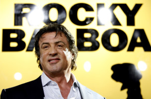 Writer, director and cast member Sylvester Stallone attends the world premiere of 'Rocky Balboa' at the Chinese theater in Hollywood, California December 13, 2006. The movie opens in the U.S. on December 20. REUTERS/Mario Anzuoni (UNITED STATES) - RTR1KDSO