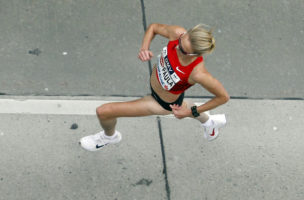 British long-distance runner and marathon world record-holder Paula Radcliffe runs shortly after the start of the Vienna city marathon, in Vienna, Austria, on Sunday, April 15, 2012. (AP Photo/Ronald Zak)
