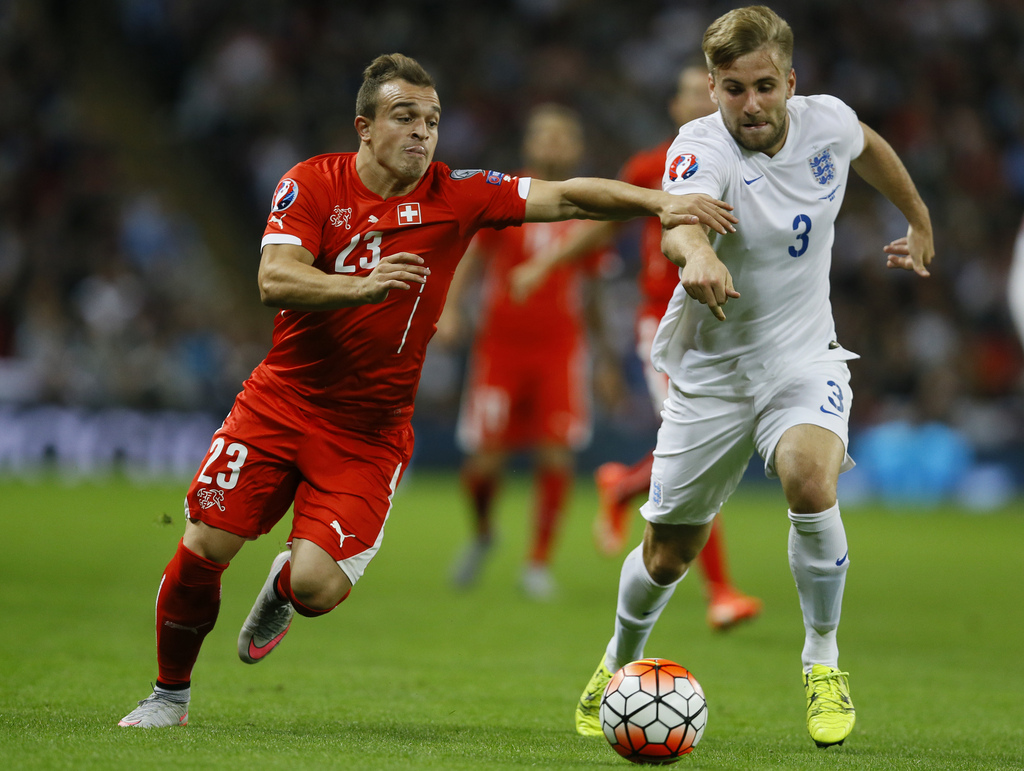 England's Luke Shaw, right battles for the ball with Switzerland's Xherdan Shaqiri during the Euro 2016 Group E qualifying soccer match between England and Switzerland at Wembley stadium in London, England, Tuesday, Sept. 8, 2015 . (AP Photo/Kirsty Wigglesworth)