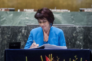 epa05272837 Doris Leuthard, the Vice President of Switzerland, arrives to sign the Paris Agreement on climate change at the United Nations Headquarters in New York, New York, USA, 22 April 2016. The Paris Agreement was adopted in Paris, France, on 12 December 2015 to limit global temperature rise to well below 2 degrees Celsius. At right is United Nations Secretary-General Ban Ki-moon.  EPA/STR