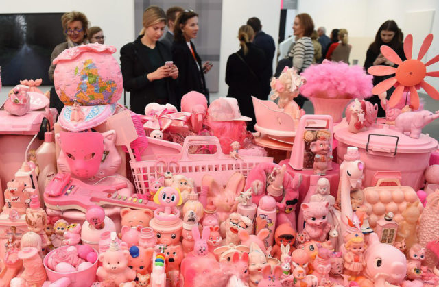 epa05573078 Visitors take photos of Portia Munson's 'Pink Project - Table' (1994) on the second day of the Frieze Art Fair in London, Britain, 06 October 2016. .London's Frieze Art Fair features more than 160 of the world's leading artists.  EPA/ANDY RAIN
