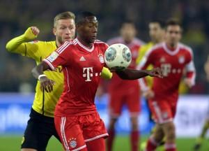 David Alaba, rechts, während eines Bundesligaspiels gegen Borussia Dortmund, 23. November 2013. (Bild: Keystone/ Federico Gambarini)