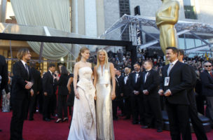 "Nicole Kidman (L) and Gwyneth Paltrow pose for photographers as they arrive at the 83rd Academy Awards in Hollywood, California, February 27, 2011. Australian actress Kidman, best actress nominee for her role in ""The Rabbit Hole,"" and Paltrow are performing best original song nominee ""Coming Home"" from the film ""Country Strong."" REUTERS/Lucy Nicholson (UNITED STATES - Tags: ENTERTAINMENT) (OSCARS-ARRIVALS)"