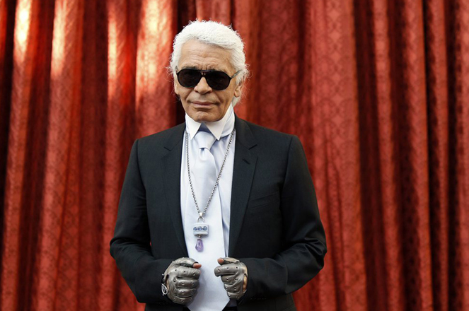 German designer Karl Lagerfeld wear's the Commander's Cross of the Legion of Honour he received from France's President Nicolas Sarkozy at a ceremony at the Elysee Palac