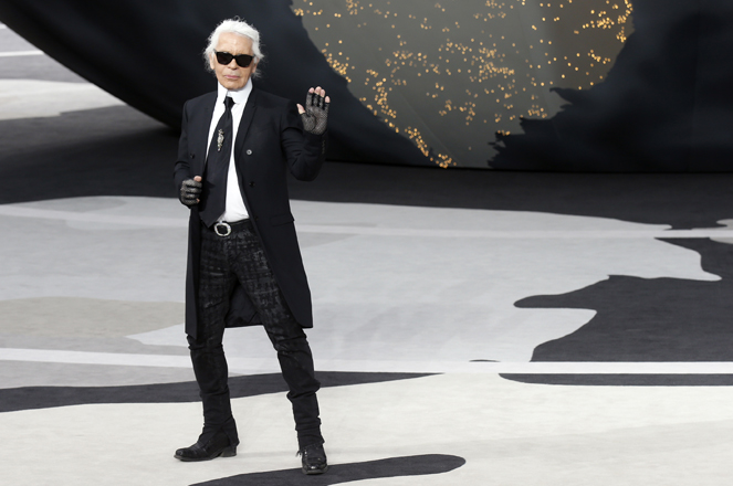 German designer Lagerfeld appears at the end of his Fall-Winter 2013/2014 women's ready-to-wear fashion show for French fashion house Chanel during Paris fashion week