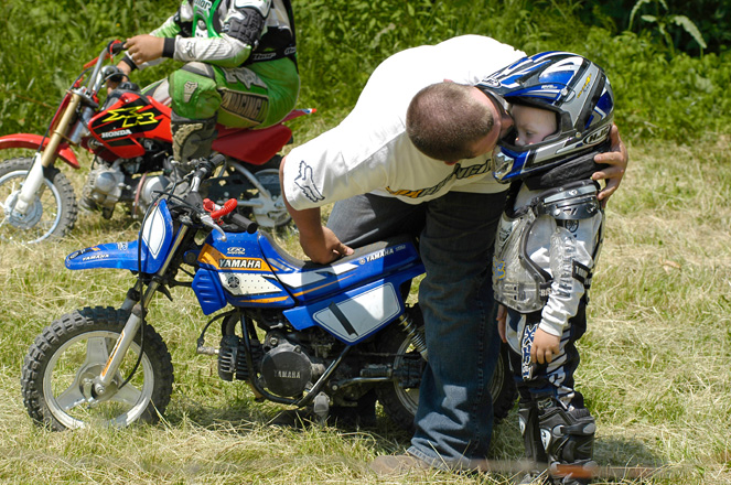 Contestants of all ages compete in a motorcycle hill climb race