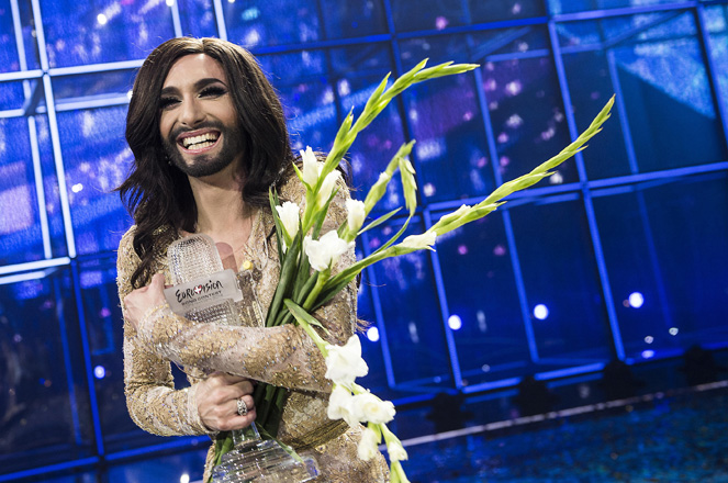 Conchita Wurst representing Austria poses with the trophy after winning the 59th annual Eurovision Song Contest in Copenhagen