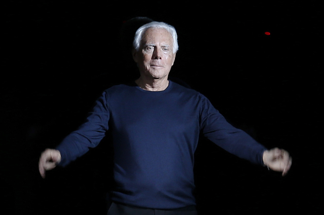 Giorgio Armani acknowledges the audience at the end of the Giorgio Armani Autumn/Winter 2014 collection during Milan Fashion Week