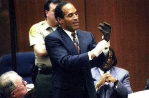 Murder defendant O.J. Simpson tries on one of the leather gloves that prosecutors say he wore