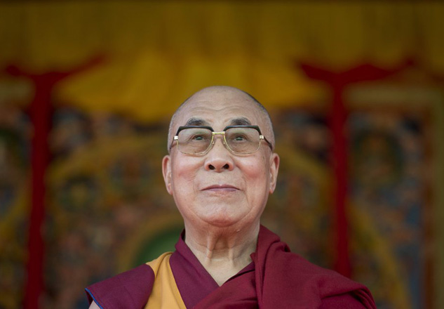 epa04823758 Tibetan spiritual leader, the Dalai Lama takes to the stage to address the audience at Aldershot, Britain, 29 June 2015. The Dalai Lama will turn 80 years of age on 06 July 2015.  EPA/WILL OLIVER