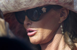 "Caitlyn Jenner, wearing a ""Caitlyn"" necklace, attends opening day of horse racing for the summer season at Del Mar Thoroughbred Club in Del Mar, Calif., on Thursday, July 16, 2015. (Cindy Yamanaka/The Orange County Register via AP)"