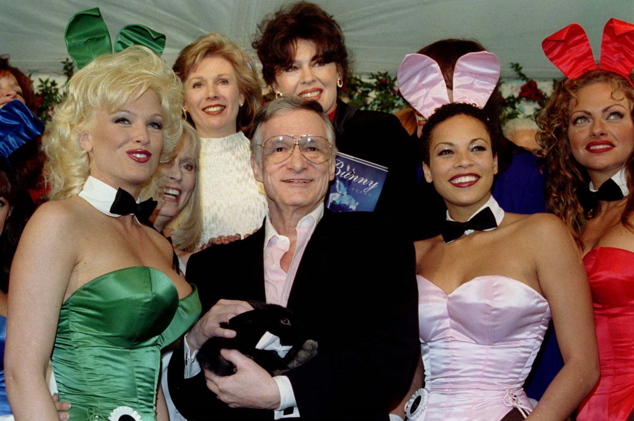 Hugh Hefner (C) , founder and publisher of Playboy magazine, is surrounded by former and present Playmates, as he holds a pet rabbit given to him for his 72nd birthday, April 9, at the Playboy Mansion in Los Angeles. Hefner was a struggling young magazine copywriter in 1953 when he turned a $600 investment and a picture of Marilyn Monroe into one of the most successful publishing empires in history. - RTXIFAD