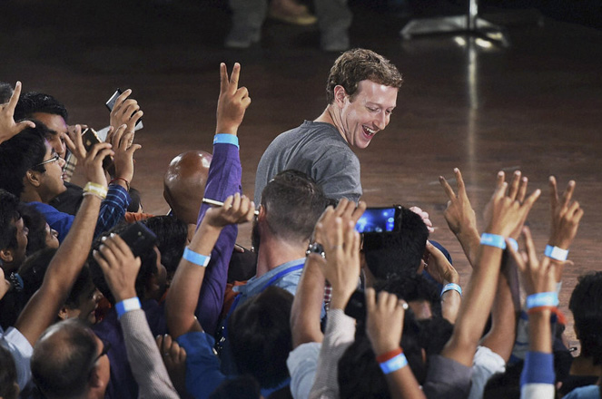 Facebook's CEO Mark Zuckerberg interacts with technology students in a town hall-style meeting in New Delhi, India, Wednesday, Oct. 28, 2015. Zuckerberg is his second visit to India this year alone. (Shirish Shete/Press Trust of India via AP)