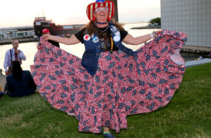 Republican U.S. presidential candidate Donald Trump supporter Susan Reneau shows off her dress during a Rock the Night kick off party on the sidelines of the Republican National Convention in Cleveland, Ohio, U.S., July 17, 2016. REUTERS/Aaron Josefczyk - RTSIFXF