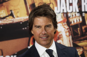 Actor Tom Cruise poses for photographers upon arrival at the premiere of the film 'Jack Reacher: Never Go Back', in Berlin, Friday, Oct. 21, 2016. (AP Photo/Markus Schreiber)