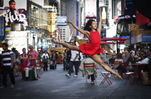 "A dancer poses for a photograph as part of the ""Dance as Art"" photo project in Times Square in New York"